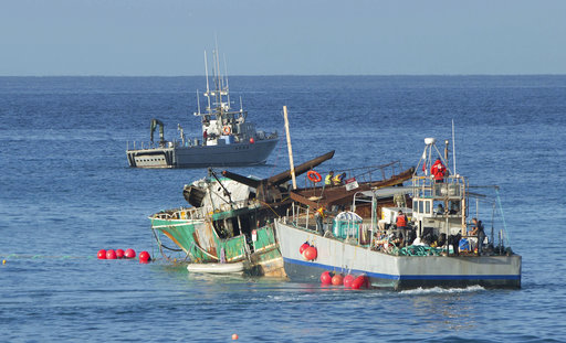 Salvage crews begin to tow the Pacific Paradise shipwreck offshore of Waikiki Beach.