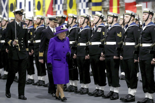 Queen Elizabeth commissions aircraft carrier with her name