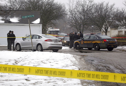 Two Ohio police officers shot and killed, suspect injured