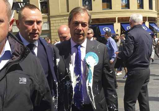 Brexiteer Farage splattered in latest UK milkshake attack