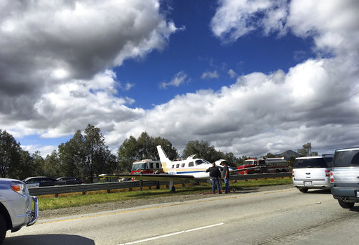 Plane lands on California highway median; no one injured