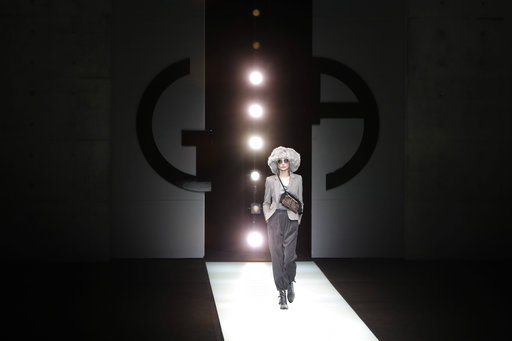 Armani denounces easy emotional appeals on and off runway