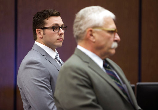 Ex-Arizona police officer acquitted in fatal hotel shooting