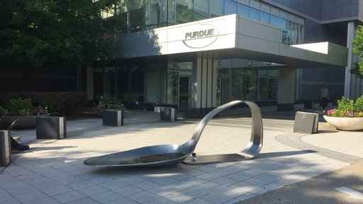 Drug spoon sculpture placed outside drugmaker headquarters