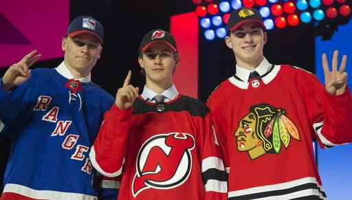 Salary cap-related trades overshadow 2nd day of NHL draft