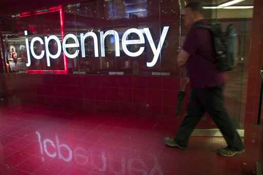 Penney posts bigger-than-expected loss, cuts outlook