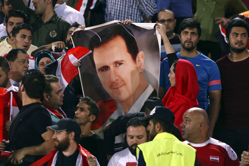 His country a smoldering ruin, but Assad still in his seat