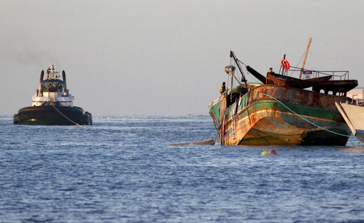 Salvage team tows wrecked fishing boat off Hawaii reef