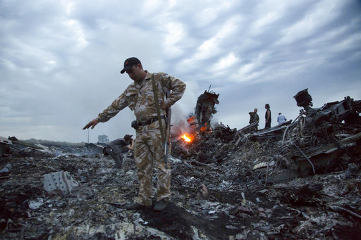 MH17 plane 'was brought down by Russian military missile', investigators say