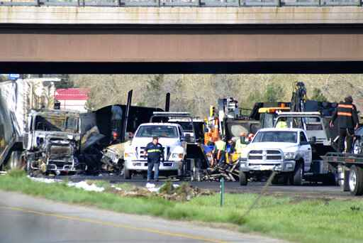 Houston truck driver held in crash that killed 4