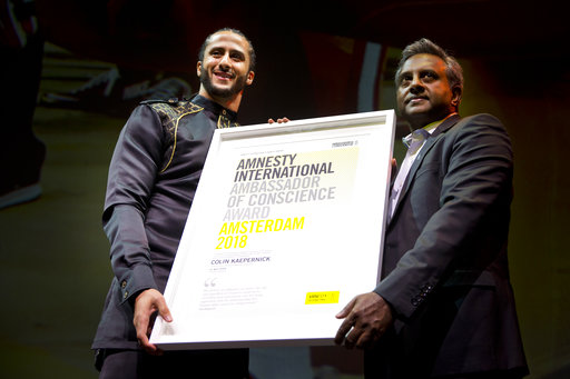 Accepting rights award, Kaepernick decries 'lawful lynching'