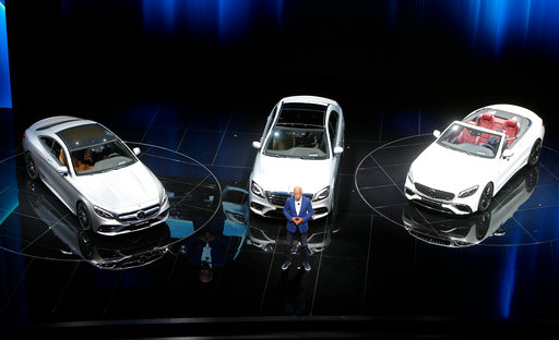 Daimler profit slips on one-time factors, but outlook raised