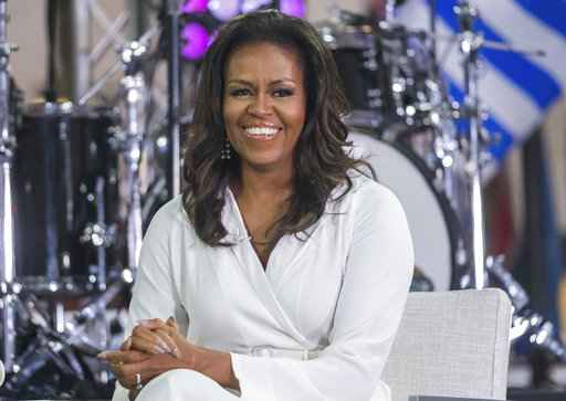 Michelle Obama reveals she had miscarriage and used IVF to conceive girls