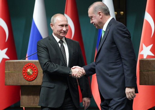 The Latest: Turkish leader notes shared views with Putin