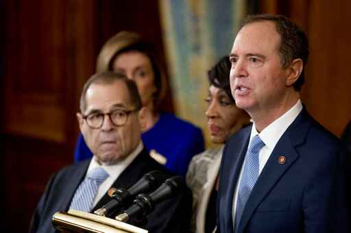 Rep. Adam Schiff, D-Calif., Chairman of the House Intelligence Committee, right, speaks with from left Chairman of the House Judiciary Committee Jerrold Nadler, D-N.Y., House Speaker Nancy Pelosi and Chairwoman of the House Financial Services Committee Maxine Waters, D-Calif., second from right, during a news conference to unveil articles of impeachment against President Donald Trump, abuse of power and obstruction of Congress, Tuesday, Dec. 10, 2019, on Capitol Hill in Washington. (AP Photo/Andrew Harnik)