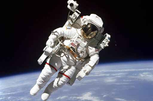 In this Feb. 7, 1984 photo made available by NASA, astronaut Bruce McCandless II, performs a spacewalk a few meters away from the cabin of the Earth-orbiting space shuttle Challenger, using a nitrogen-propelled Manned Maneuvering Unit. On Wednesday, April 1, 2020, NASA said that more than 12,000 Americans from all 50 states, the District of Columbia and four U.S. territories applied to be part of the space agency's next astronaut class. The month-long application period ended Tuesday. (NASA via AP)