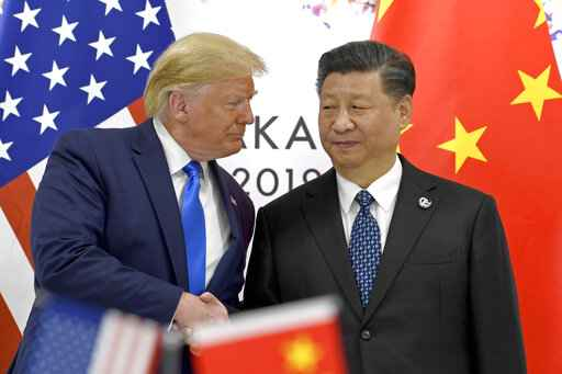 FILE - In this June 29, 2019, file photo, U.S. President Donald Trump, left, shakes hands with Chinese President Xi Jinping during a meeting on the sidelines of the G-20 summit in Osaka, western Japan. The ongoing sharp deterioration in U.S.-China ties poses risks to both countries and the rest of the world. With the U.S. presidential campaign heating up, all bets are that relations with China will only get worse. At stake are global trade, technology and security. (AP Photo/Susan Walsh, File)
