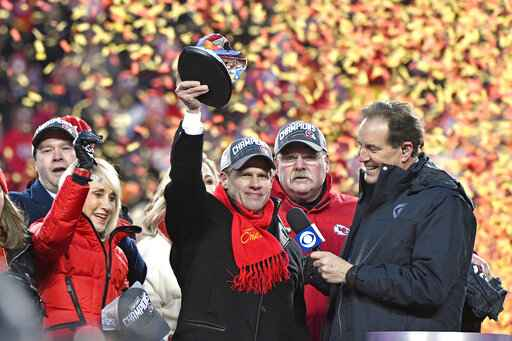 Norma Hunt, left, and her son Clark Hunt, center, owners of the Kansas City Chiefs, and Kansas City Chiefs head coach Andy Reid, second right, celebrate after the NFL AFC Championship football game against the Tennessee Titans Sunday, Jan. 19, 2020, in Kansas City, MO. The Chiefs won 35-24 to advance to Super Bowl 54. (AP Photo/Jeff Roberson)