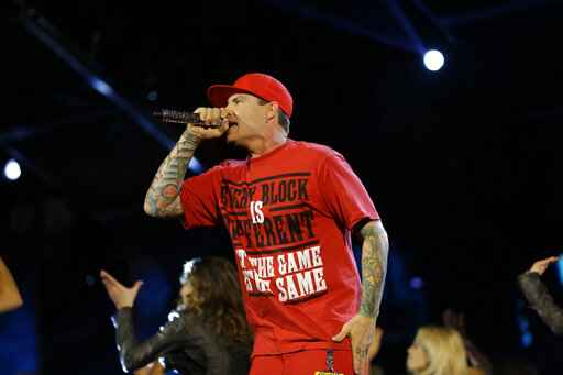 FILE - In this Feb. 15, 2014 file photo, singer Vanilla Ice performs during the skills competition at the NBA All Star basketball game, in New Orleans. Vanilla Ice has indefinitely postponed a Texas concert that had drawn fierce criticism due to the coronavirus pandemic. The 1990s rapper with the hit single
