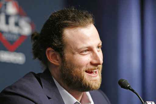 FILE - In this Oct. 14, 2019, file photo, Houston Astros starting pitcher Gerrit Cole talks to the media at Yankee Stadium in New York, on an off day during the American League Championship Series between the Astros and the New York Yankees. The New York Yankees landed the biggest prize of the free agent market, adding Gerrit Cole to their rotation with a record $324 million, nine-year contract on Tuesday night, a person familiar with the deal told The Associated Press. The person spoke on condition of anonymity because the agreement had not been announced. (AP Photo/Kathy Willens, File)