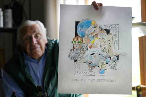 Artist Robert Seaman holds up the 365th daily doodle sketch in his room at an assisted living facility Monday, May 10, 2021, in Westmoreland, N.H. Seaman, who moved into the facility weeks before the COVID-19 pandemic shutdown his outside world in 2020, recently completed his 365th daily sketch, or what he calls his