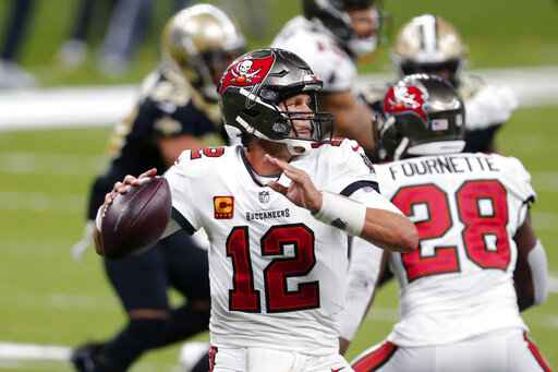 Tampa Bay Buccaneers quarterback Tom Brady (12) passes in the second half of an NFL football game against the New Orleans Saints in New Orleans, Sunday, Sept. 13, 2020. (AP Photo/Brett Duke)