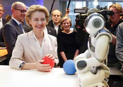 President of the European Commission Ursula von der Leyen looks at the invention 'Do you Speak Robot?' at the AI Xperience Center at the VUB (Vrije Universiteit Brussel) in Brussels, Tuesday, Feb. 18. 2020. (Stephanie Lecocq, Pool Photo via AP)