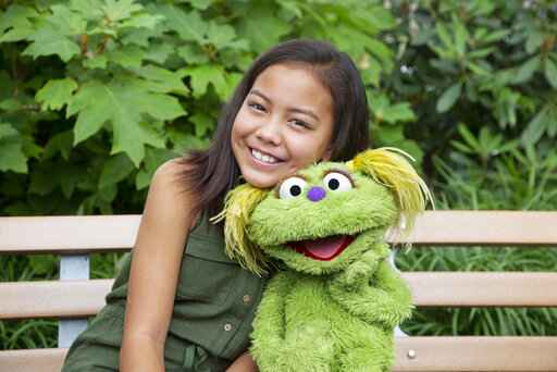 This undated image released by Sesame Workshop shows 10-year-old Salia Woodbury, whose parents are in recovery, with