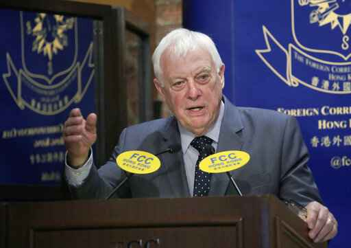 In this Sept. 19, 2017, photo, Chris Patten, Hong Kong's last British governor, listens to questions at The Foreign Correspondents' Club to promote his new book in Hong Kong. Patten, is urging protesters in Hong Kong not to