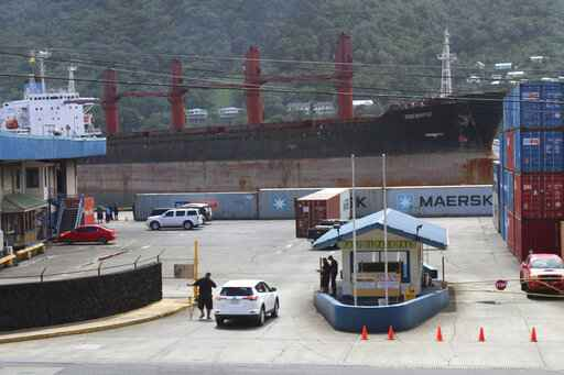 FILE - This May 11, 2019, file photo shows the North Korean cargo ship Wise Honest docking in Pago Pago, American Samoa. The U.S. Coast Guard says a seized North Korean cargo ship, the Wise Honest, suspected of being used to violate international sanctions, has been sold and towed from American Samoa. (AP Photo/Fili Sagapolutele, File)
