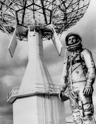 FILE- In this June 18, 1963 file photo astronaut John Glenn, the first American to orbit the earth, posing before a Project Mercury tracking station at Cape Canaveral, Fla. A panel is scheduled to vote Thursday, Feb. 25, 2021, on bringing a statue of the late astronaut and U.S. senator to the Ohio Statehouse to mark major future milestones, such as his birthday and the anniversary of his famous space flight. Glenn died in 2016 at age 95. (AP Photo, File)