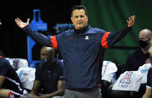 FILE - Arizona head coach Sean Miller questions a call during the second half of an NCAA college basketball game against Arizona in Eugene, Ore., in this Monday, March 1, 2021, file photo. Arizona has parted ways with men's basketball coach Sean Miller as the program awaits its fate in an NCAA infractions investigation, a person with knowledge of the situation told The Associated Press. The person told the AP on condition of anonymity Wednesday, April 7, 2021, because no official announcement has been made. (AP Photo/Andy Nelson, File)