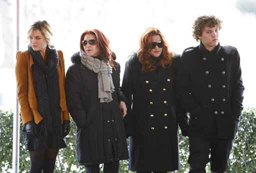 FILE - In this Jan. 8, 2010, file photo, Priscilla Presley, second from left, her daughter, Lisa Marie Presley, second from right, and Lisa Marie's children, Riley Keough, left, and Benjamin Keough, right, take part in a ceremony in Memphis, Tenn., commemorating Elvis Presley's 75th birthday. Keough has died. Lisa Marie Presley's representative Roger Widynowski said in a statement Sunday, July 12, 2020, to The Associated Press that she was