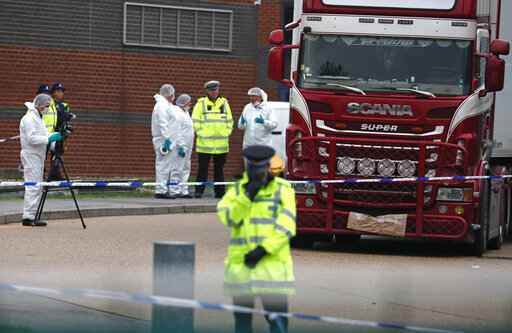 Police forensic officers attend the scene after a truck was found to contain a large number of dead bodies, in Thurrock, South England, Wednesday Oct. 23, 2019. Police in southeastern England said that 39 people were found dead Wednesday inside a truck container believed to have come from Bulgaria. (AP Photo/Alastair Grant)