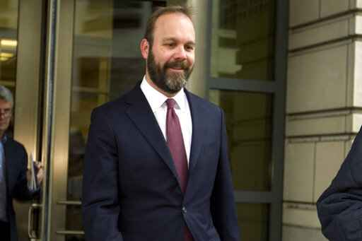 FILE - In this Feb. 23, 2018 file photo, Rick Gates leaves federal court in Washington. Federal prosecutors are asking a judge to set a sentencing date for next month for former Trump campaign official Gates. The request on Monday, Nov. 11, 2019, is a sign that Gates' extensive cooperation with the government is coming to an end. (AP Photo/Jose Luis Magana)