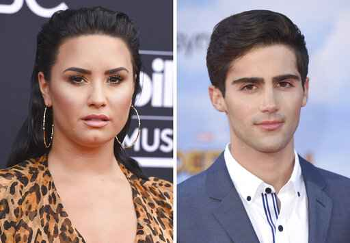 In this combination photo, Demi Lovato, left, arrives at the Billboard Music Awards on May 20, 2018, in Las Vegas and Max Ehrich arrives at the
