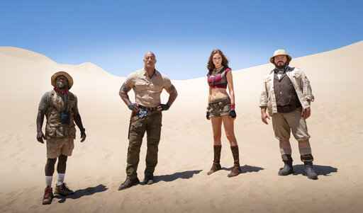 This image released by Sony shows Kevin Hart, from left, Dwayne Johnson, Karen Gillan and Jack Black in a scene from