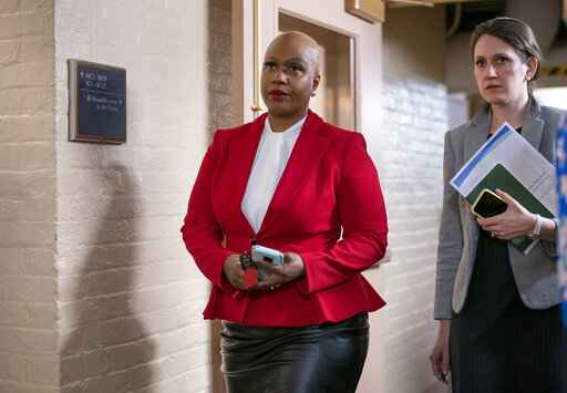 FILE - In this Wednesday, March 11, 2020, file photo, Rep. Ayanna Pressley, D-Mass., and other House Democrats arrive to meet with Speaker of the House Nancy Pelosi, D-Calif., on Capitol Hill in Washington. Democratic lawmakers are calling out an apparent lack of racial data that they say is needed to monitor and address disparities in the national response to the coronavirus outbreak. Massachusetts Sen. Elizabeth Warren and Rep. Ayanna Pressley say in a letter to Health and Human Services Secretary Alex Azar dated Friday, March 27, 2020, that comprehensive demographic data on people who are tested or treated for the coronavirus does not exist. (AP Photo/J. Scott Applewhite, File)