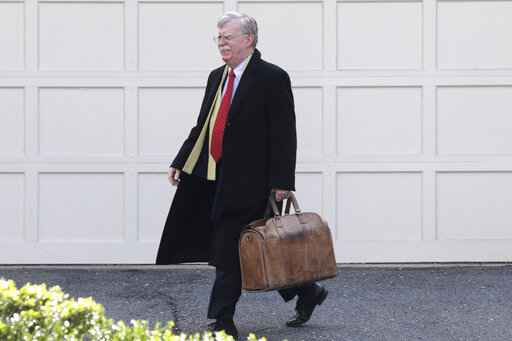 Former National security adviser John Bolton leaves his home in Bethesda, Md. Tuesday, Jan. 28, 2020. President Donald Trump's legal team is raising a broad-based attack on the impeachment case against him even as it mostly brushes past allegations in a new book that could undercut a key defense argument at the Senate trial. Former national security adviser John Bolton writes in a manuscript that Trump wanted to withhold military aid from Ukraine until it committed to helping with investigations into Democratic rival Joe Biden.�(AP Photo/Luis M. Alvarez)