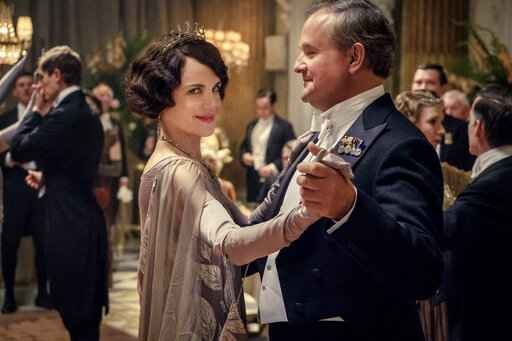 This image released by Focus Features shows Elizabeth McGovern, left, as Lady Grantham and Hugh Bonneville, as Lord Grantham, in