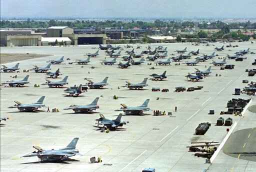 FILE - In this April 14, 1999, file photo, F-16 Fighting Falcons sit on the tarmac at Luke Air Force Base in Glendale, Ariz. The U.S. Air Force says it will be distributing bottled water until at least April to thousands of residents and business owners near Luke Air Force Base in suburban Phoenix in the latest case of fire firefighting foam from a military base contaminating a nearby community's water supply. (AP Photo/Ken Levine, File)