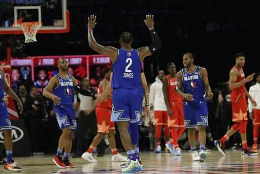 LeBron James of the Los Angeles Lakers celebrates during the second half of the NBA All-Star basketball game Sunday, Feb. 16, 2020, in Chicago. (AP Photo/Nam Huh)