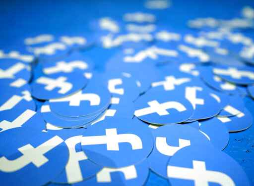 FILE - In this April 30, 2019, file photo, Facebook stickers are laid out on a table at F8, Facebook's developer conference in San Jose, Calif. Ever since Russian agents and other opportunists abused its platform in an attempt to manipulate the 2016 U.S. presidential election, Facebook has insisted, repeatedly, that it's learned its lesson and is no longer a conduit for misinformation, voter suppression and election disruption. (AP Photo/Tony Avelar, File)