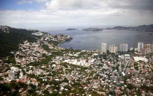 FILE - This Sept. 20, 2013 file photo shows an aerial view of the Pacific resort city of Acapulco, Mexico. The Mexican coastal city pulled a pair of controversial video ads Thursday, Aug. 6, 2020, touting the faded resort's reputation as an