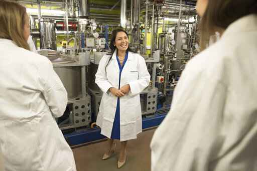 Britain's Home Secretary Priti Patel meets students and staff working on 'carbon capture' at Imperial College London in South Kensington, London, Tuesday Feb. 18, 2020. Britain has announced a new post-Brexit