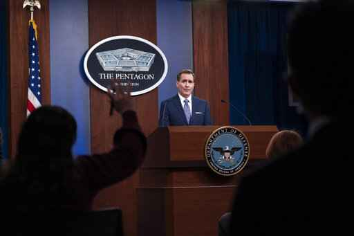 FILE - In this Feb. 17, 2021, file photo, Pentagon spokesman John Kirby speaks during a media briefing at the Pentagon in Washington. A U.S. airstrike targeting facilities used by Iran-backed militias in Syria appears to be a message to Tehran delivered by a new American administration still figuring out its approach to the Middle East. Kirby said the operation in Boukamal, Syria, sends an unambiguous message: