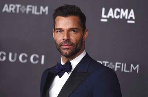 "FILE - This Nov. 2, 2019 file photo shows Ricky Martin at the 2019 LACMA Art and Film Gala in Los Angeles. Martin will perform his latest song ""Cántalo"" with Residente and Bad Bunny at the Latin Grammy Awards on Thursday, Nov., 14, and will also serve as master of ceremonies along actresses Roselyn Sánchez and Paz Vega. (Photo by Jordan Strauss/Invision/AP, File)"