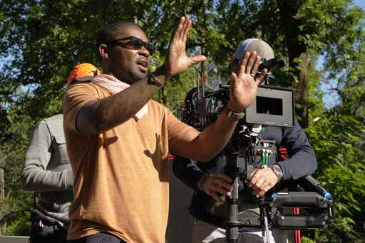 This image released by RLJE films shows actor-director David Oyelowo on the set of