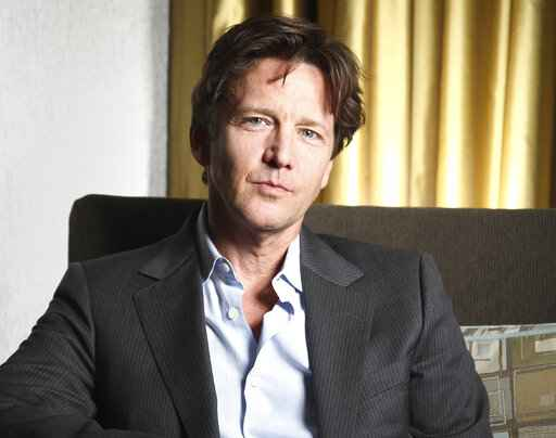 FILE - Actor Andrew McCarthy poses for a portrait during the 36th Toronto International Film Festival in Toronto, Canada on Sept. 9, 2011. McCarthy released his new memoir on May 11. 2021 titled,