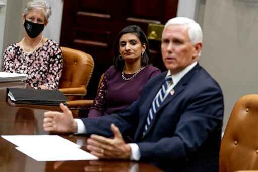 Vice President Mike Pence, right, accompanied by Seema Verma, Administrator of the Centers for Medicare and Medicaid Services, center, answers a reporters question about his former homeland security advisor Olivia Troye, who criticized President Donald Trump's handling of the pandemic, Thursday, Sept. 17, 2020, during a meeting on safety and quality for nursing homes in the Roosevelt Room of the White House in Washington. (AP Photo/Andrew Harnik)
